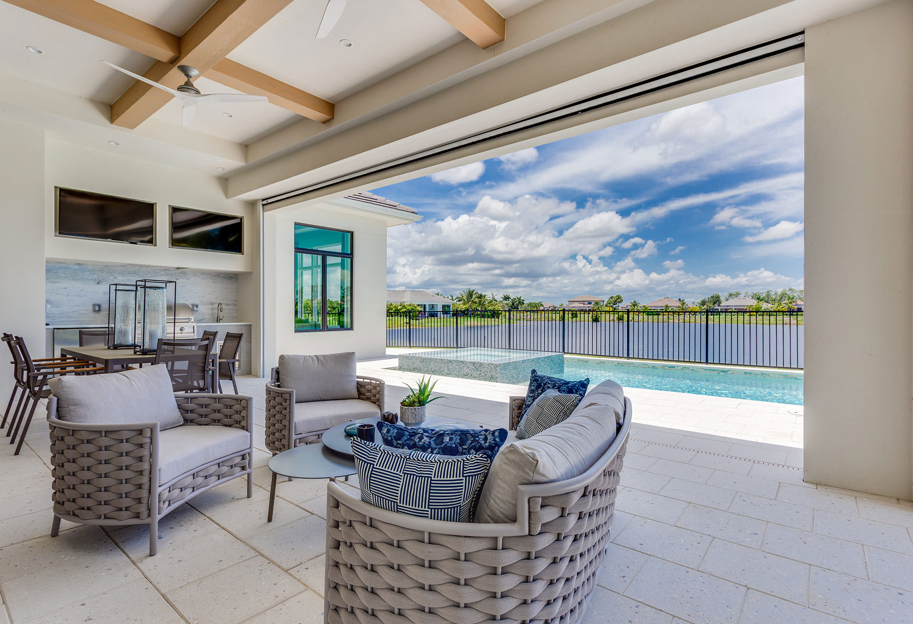 A pool view of the new Caprina model, now available for viewing daily in the Peninsula at Treviso Bay.